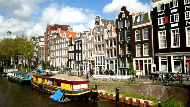 Amsterdam houses with ships, panning video