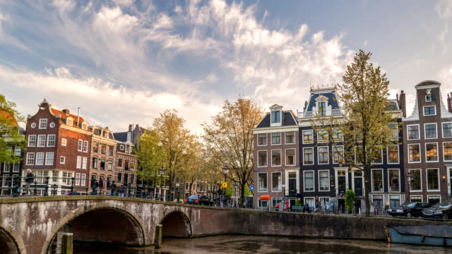 Amsterdam Netherlands time lapse 4K, city skyline sunset timelapse at canal waterfront Amsterdam Netherlands time lapse 4K, city skyline sunset timelapse at canal waterfront amsterdam stock videos & royalty-free footage