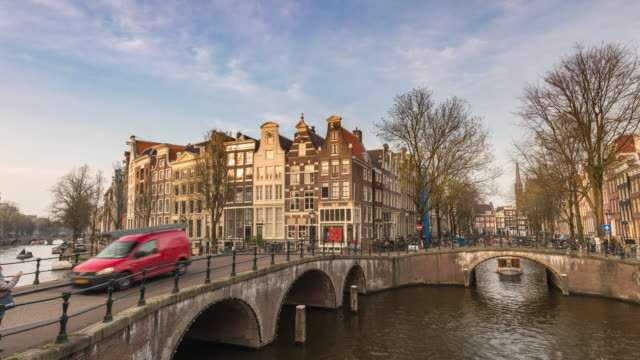 amsterdam netherlands time lapse 4k, city skyline timelapse at canal waterfront - canale video stock e b–roll