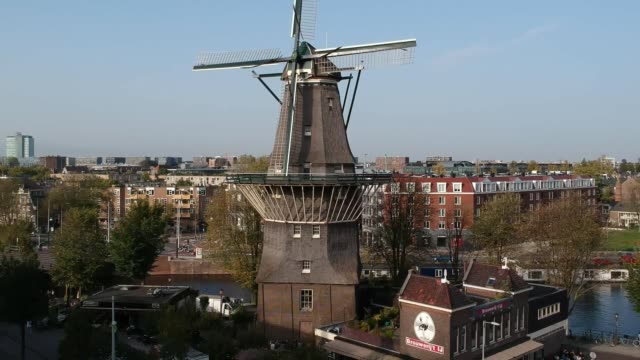 Amsterdam Netherlands Windmill Grachten Aerial Footage Amsterdam Netherlands Windmill Grachten Aerial Footage Chinese Boat architectural column stock videos & royalty-free footage