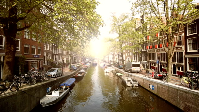 Amsterdam Skyline with Canal and sun video