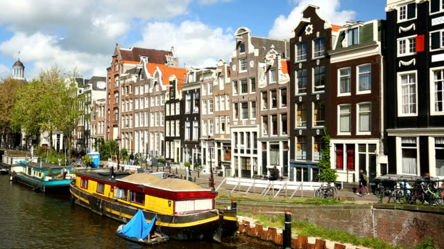 amsterdam skyline with canal, panning - amsterdam video stock e b–roll