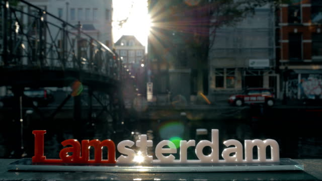 I amsterdam slogan and city view with canal video