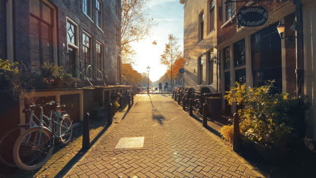 amsterdam street in golden sun - amsterdam video stock e b–roll