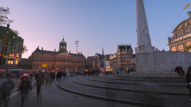 amsterdam/Netherlands-Oct 30 2019:4k uhd timelapse Amsterdam  Dam Square and royal palace scene in front of the historic National with crowd tourists