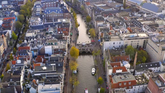 Amsterdam/Netherlands-Oct 31 2019: uhd 4k Drone arrial view of of Prinsengracht canal the famous spot with old tradition house and church in Amsterdam, the Netherlands Amsterdam/Netherlands-Oct 31 2019: uhd 4k Drone arrial view of of Prinsengracht canal the famous spot with old tradition house and church in Amsterdam, the Netherlands amsterdam stock videos & royalty-free footage