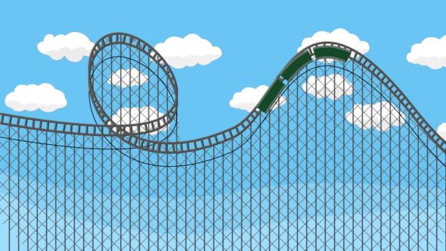vídeos de stock, filmes e b-roll de coaster do rolo do parque de diversões com um céu azul - rollercoaster