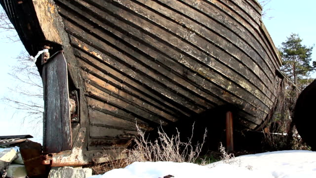 An abandoned wrecked boat An abandoned wrecked wooden boat placed near the shore with grasses growing on it baltic countries stock videos & royalty-free footage