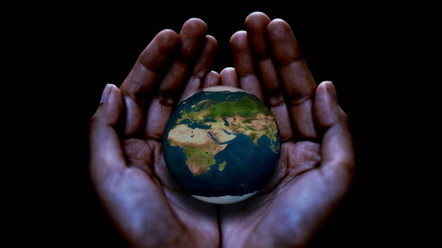 an abstract concept of holding the world in your hands - geografia fisica video stock e b–roll