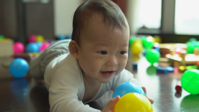 An adult's viewpoint may be a parent looking at a baby who is crawling into himself, with the sunlight behind him. It is the first concept of human learning in trying to achieve success. Conveys the cuteness of the baby.