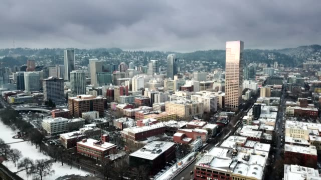 An aerial hyperlapse footage of Portland downtown and the bridges over the river video