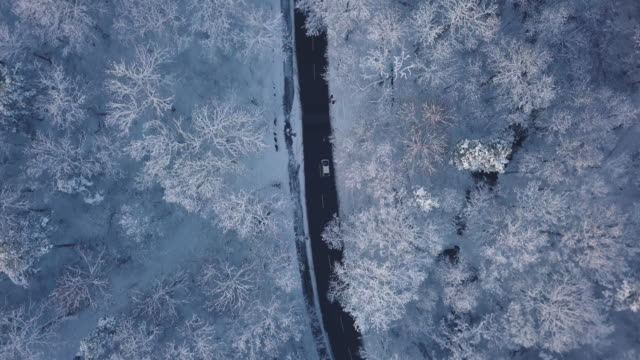 an aerial road trip over snowy landscapes - aerial road stock videos & royalty-free footage