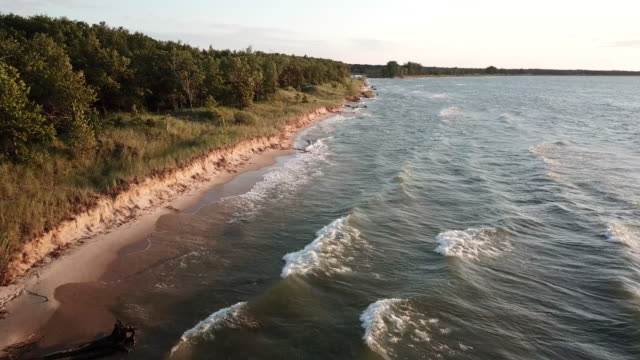 An aerial view of a beach on Lake Huron Michigan on a very windy day