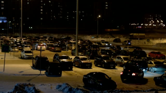 An Aerial View Of A Crowded Parking Lot At Night Stock Video - Download  Video Clip Now - iStock