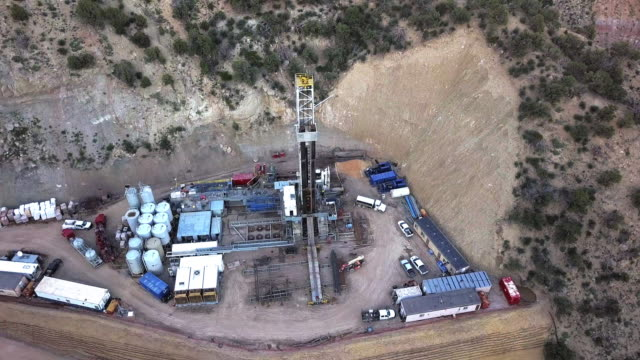 An Aerial View Of A Fracking Drill Rig On The Side Of A Mountain In Colorado In Late Spring