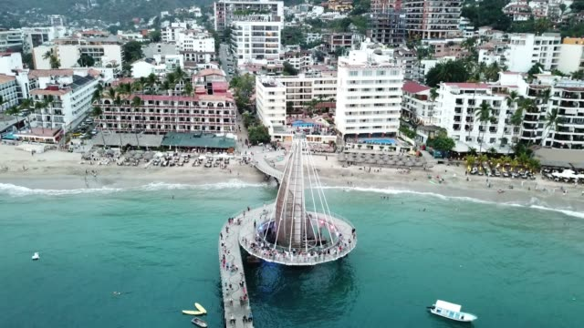 An Aerial View Of El Malecon Boardwalk, Muelle Pier And City Of Puerto Vallarta, Mexico