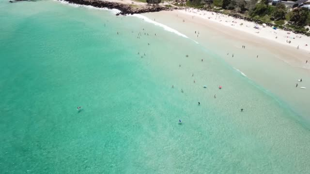 An aerial view of the beach in Byron Bay