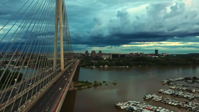 en flygbild av den berömda ada-bron i belgrad, serbien vid sunset video - serbien bildbanksvideor och videomaterial från bakom kulisserna
