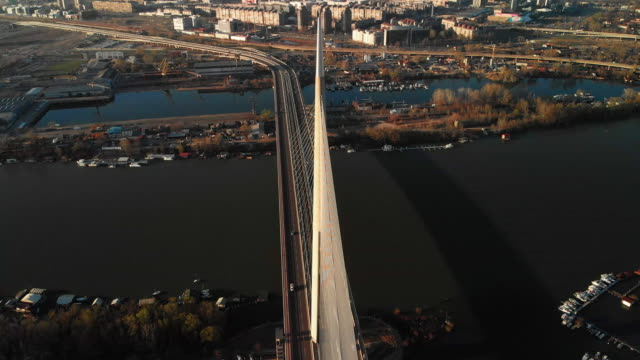 an aerial view of the famous ada bridge in belgrade, serbia at winter - serbia video stock e b–roll