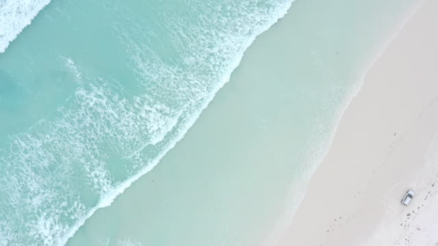 An aerial view of waves crashing on Beach in Esperance, Western Australia.