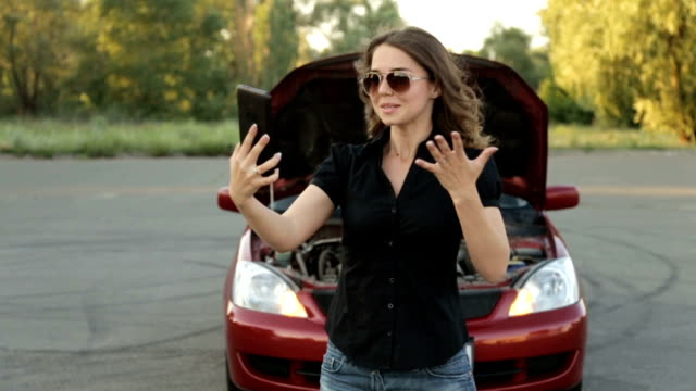 An agitated girl and a broken car on the road. A call to the car service video