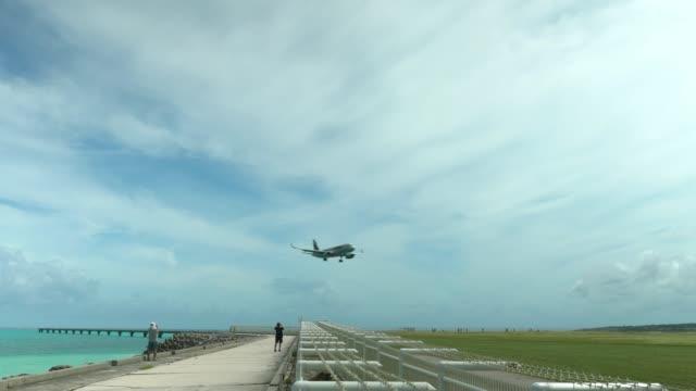 An aircraft landing at Shimojishima Airport in Shomojishima island, Japan video