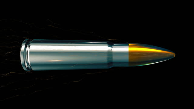 An AK47 Gold tipped silver bullet flying through the air in slow motion against a black background.