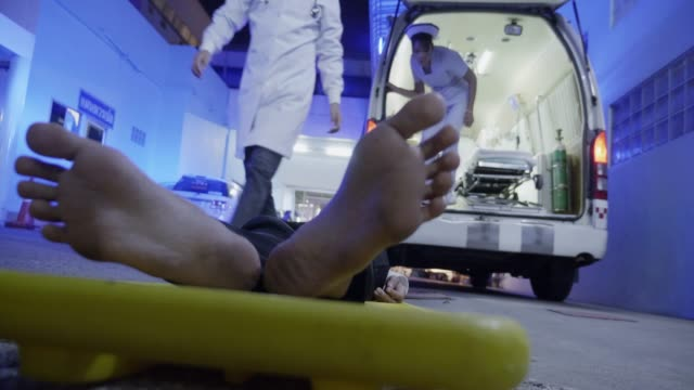 An ambulance with a patient.Hospital Emergency Team Carrying Stretcher with Patient. video