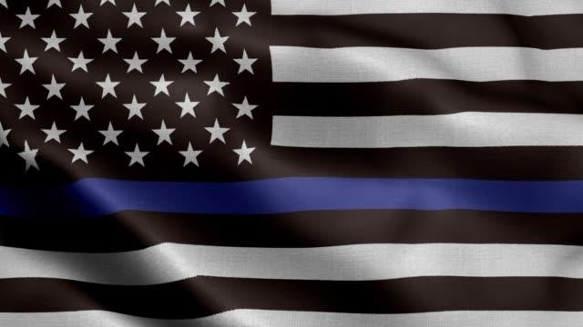 eine amerikanische flagge symbolisch für die unterstützung für die strafverfolgung, usa flagge winken animation - material stock-videos und b-roll-filmmaterial