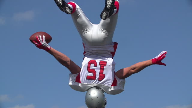 An American Footballer celebrates with a backflip. video