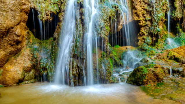 An ancient waterfall resembling a skull. 4K timelapse video