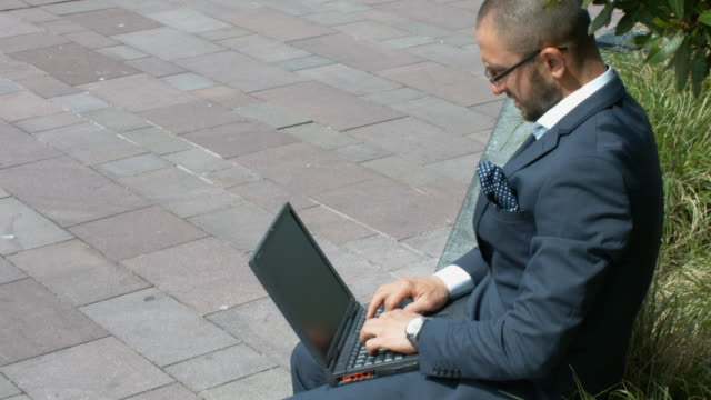 An Angry Businessman Breaking His Laptop. video