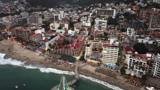 An Areal View Of El Malecon Boardwalk, Muelle Pier And City Of Puerto Vallarta, Mexico