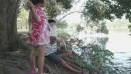 istock An Asian brother and sister were feeding the fish inside the park. Happy boy and girl in the summer. 1282329433