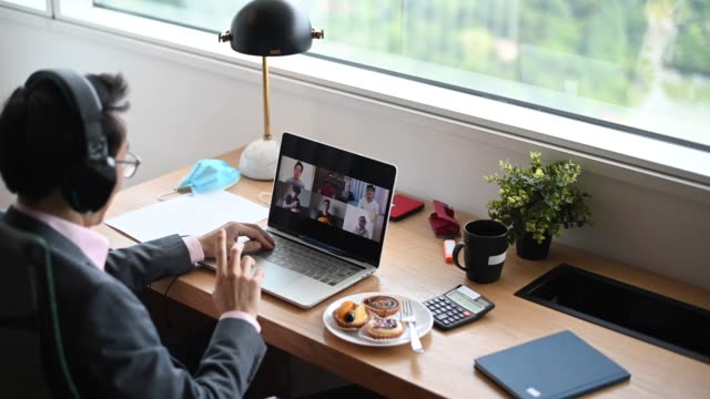 an asian chinese mid adult businessman typing and replying email to his customer in the office using laptop an asian chinese mid adult businessman typing and replying email to his customer in the office using laptop endurance stock videos & royalty-free footage