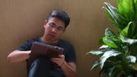 istock an asian chinese mid adult man at home using digital tablet to drraw 1222338435