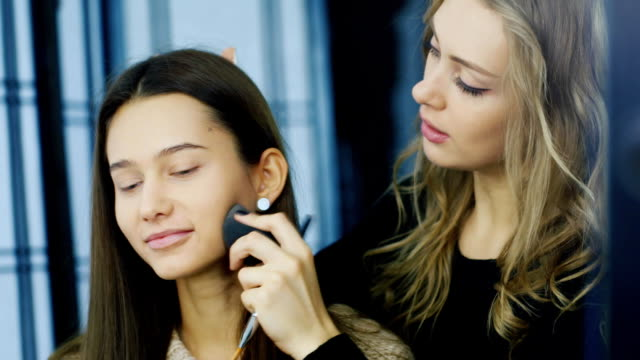 An attractive dark-haired girl applied make-up video