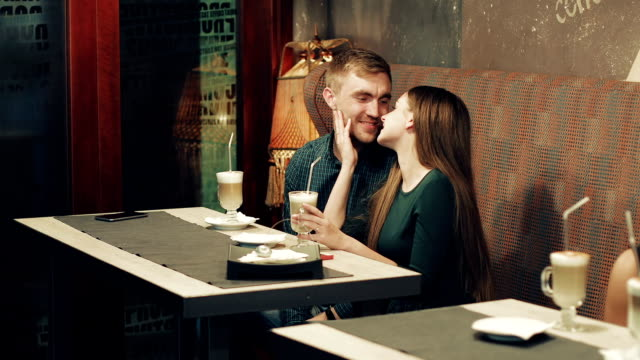 an attractive young couple is resting in a cafe. - data scritta video stock e b–roll