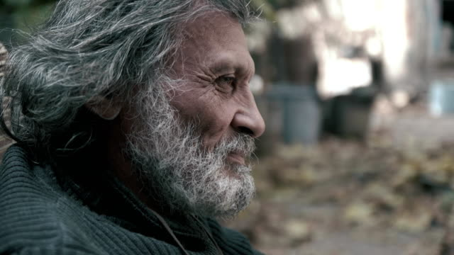 An elderly Afghan man looks at the camera (close-up) video