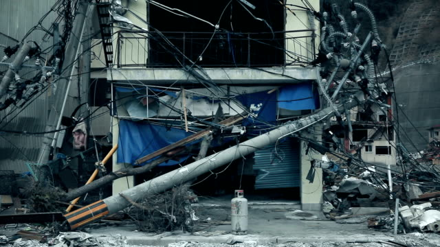 an electric pole has fallen in the house. city after the tsunami :  04/30/2011 fukushima in japan - evento catastrofico video stock e b–roll