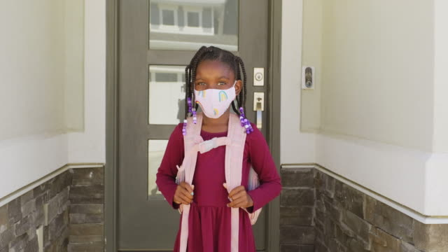 An Elementary School Student Going to School with Face Mask