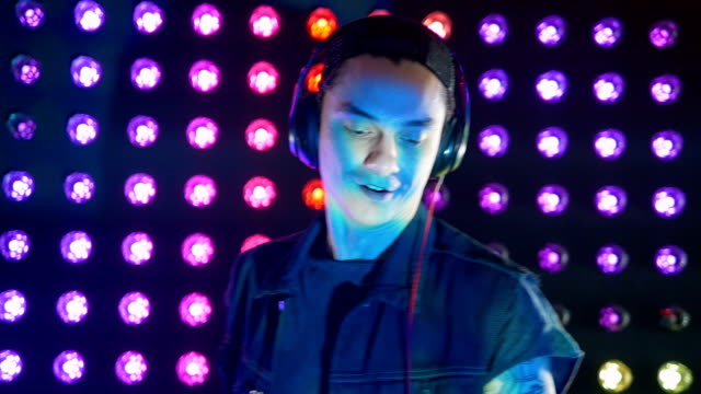 An energetic DJ nods and moves to the music. video