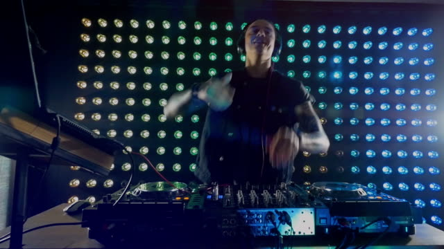 An energetic DJ working at the mixer. video