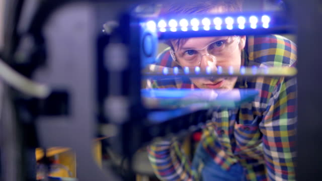 An engineer controls 3d-printer work. video