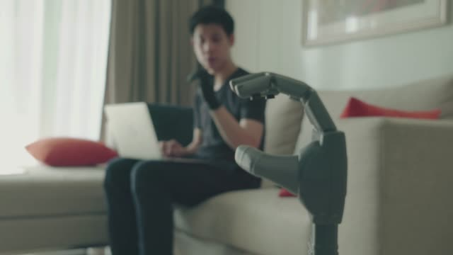 An engineer  developing robotic arm An engineer  developing robotic arm robot arm stock videos & royalty-free footage