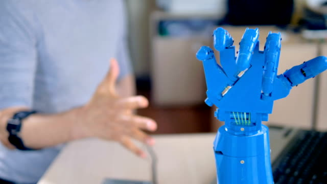 an engineer making fists to test bionic hand. - ai stock videos & royalty-free footage