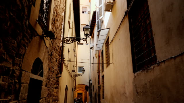 An original narrow street with old houses in the historic part of Florence. Steadicam shot video