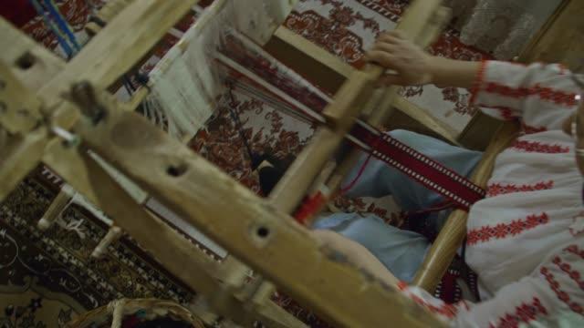 an overhead pan shot of weaver. - молдавия стоковые видео и кадры b-roll