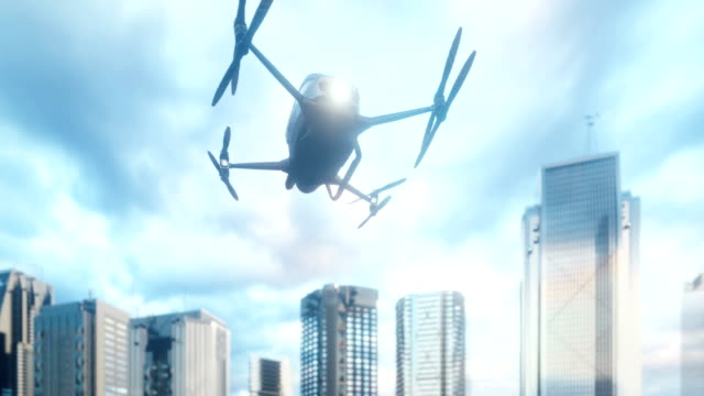 An unmanned passenger drone has flown in to pick up its passenger on a cloudy day. The concept of the future unmanned air taxi. 3D rendering of animation.