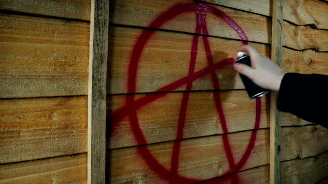Anarchy Symbol Spray Painted On Wood Fence